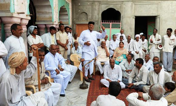 In this photograph taken on May 5, 2014 Inder Singh More, the head of the 42-village Khap panchayat or local village council, speaks during a meeting in Hissar district of the northern state of Haryana.