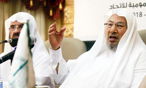 Youssef al-Qaradawi (R), chairman of the International Union of Muslim Scholars, speaks during a news conference in Doha on June 23, 2014. Qaradawi on Monday said that only dialogue could solve Iraq's crisis, sounding a conciliatory note on the threat posed by Islamic State (IS) insurgents that could further polarize the Middle East along sectarian lines.