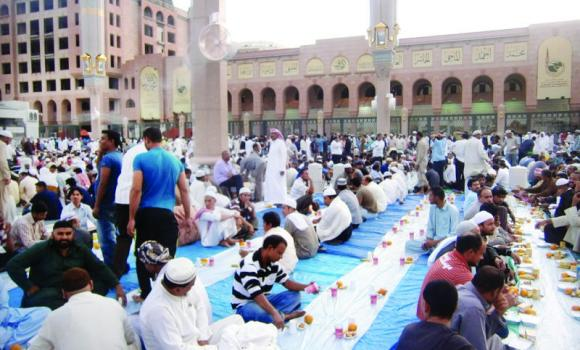 Muslims wait for the call to Maghreb prayer to break their Ramadan fast in the courtyard of the Prophet's Mosque.