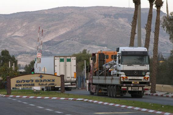 Trucks drive on Sheikh Hussein Bridge on the Israel-Jordan border.