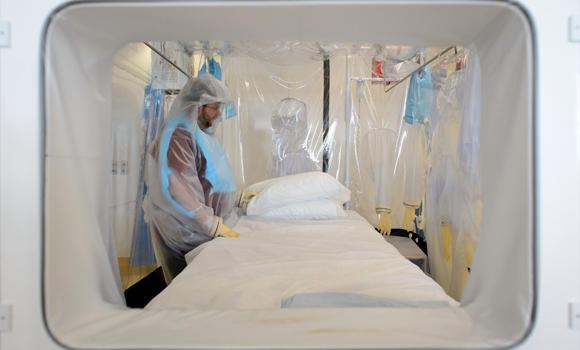 A nurse wears protective clothing as he demonstrates the facilities in place at the Royal Free Hospital in north London in preparation for a patient testing positive for the Ebola virus. The Saudi Health Ministry denied Thursday the appearance of a second Ebola virus fever case in Jeddah.