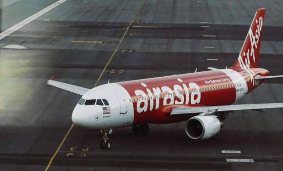 An AirAsia plane is seen on the runway at Kuala Lumpur International Airport.