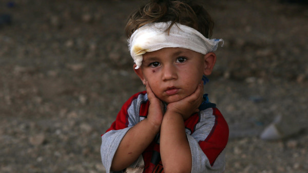 An Iraqi Yazidi child, whose family fled their home a week ago when ISIS militants attacked the town of Sinjar.