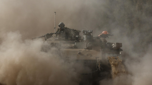 An Israeli soldier rides atop an armoured personnel carrier (APC) near the border of southern Gaza Strip August 1, 2014.