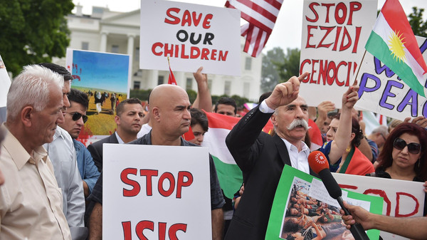 Demonstrators call for the end to Islamic State of Iraq and Syria (ISIS) terrorism during a Kurdish demonstration in front of the White House.