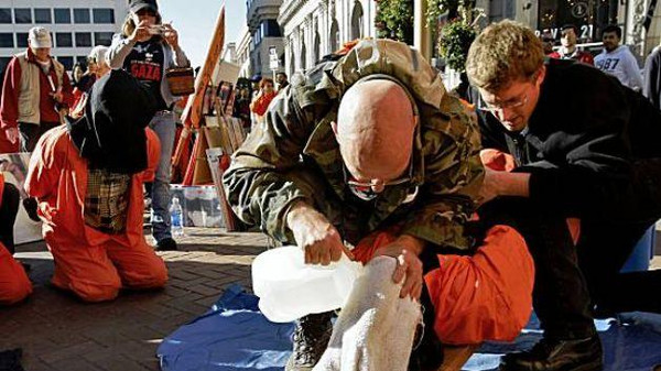 U.S. activists emulate waterboarding technique used on Sep. 11 prisoners at a protest in San Francisco in 2009.