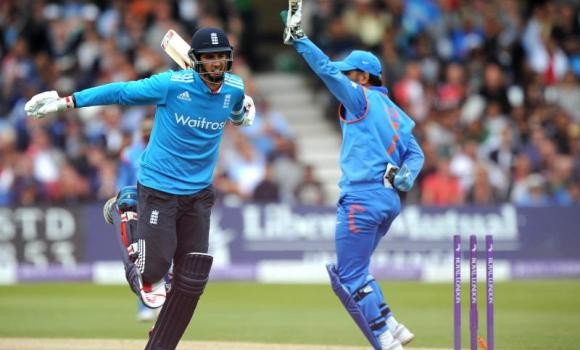 England's Steven Finn is run out by India's MS Dhoni during the third one-day international cricket match between England and India at Trent Bridge in Nottingham, central England.