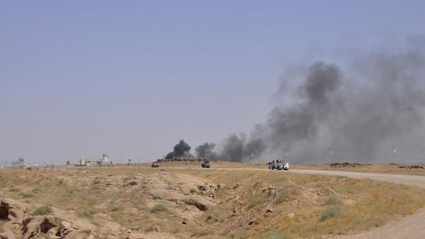 Smoke rises during clashes between Iraqi security forces and militants of the Islamic State in Iraq and the Syria in the Hamrin mountains in Diyala province.