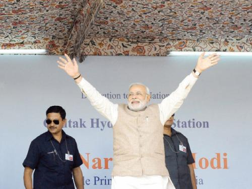 Indian Prime Minister Narendra Modi waves to supporters during a public rally in Kargil, India, on Tuesday.