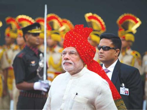 Indian Prime Minister Narendra Modi, shown in this file photo inspecting a guard of honor as he arrives at the Red Fort monument on Indian Independence Day, is perceived as more business friendly than the previous left-leaning Congress government.