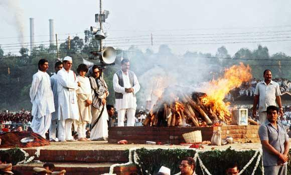 In this November 3, 1984 file photo shows India's then Premier Rajiv Gandhi (2L), accompanied by his Italian-born wife Sonia (3L), his daughter Priyanka (C) and bodyguards as they stand at the cremation site of his mother Indira Gandhi in New Delhi.
