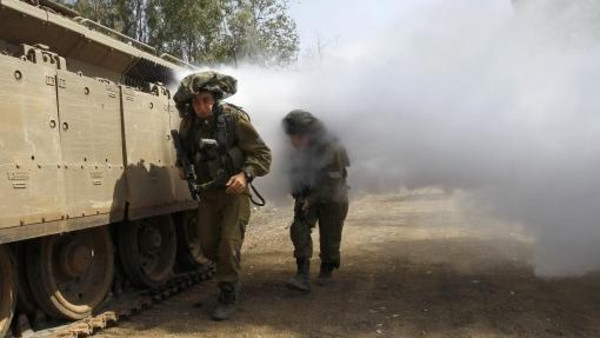 Israeli soldiers train in urban warfare close to the ceasefire line between Israel and Syria on the Israeli occupied Golan Heights May 6, 2013.