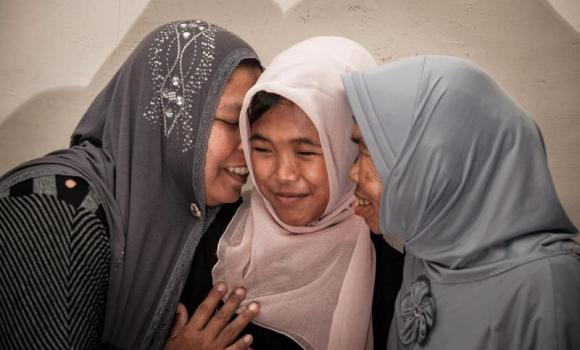 Jamaliah gives a hug to her daughter Raudhatul Jannah after being reunited in Meulaboh, Aceh, northern Sumatra, Indonesia.