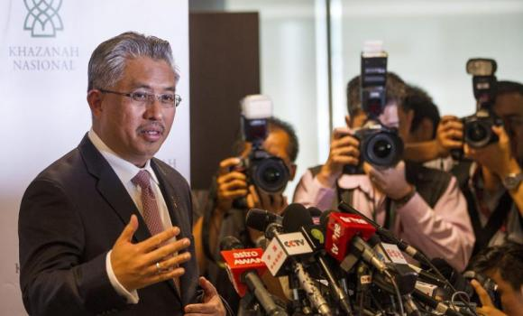 Khazanah Nasional Managing Director Azman Mokhtar outlines the Malaysia Airlines' recovery plan during a media conference in Kuala Lumpur.