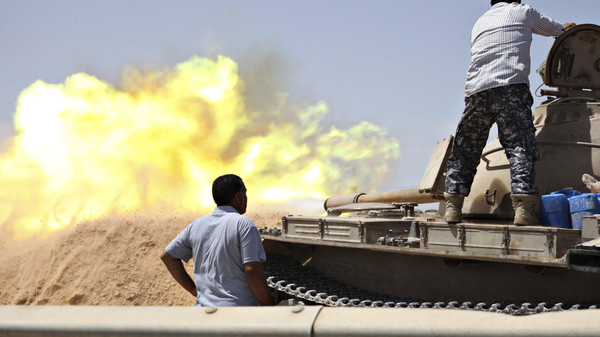 A tank belonging to the Western Shield, a branch of the Libya Shield forces, fires during a clash with rival militias around the former Libyan army camp, Camp 27, in the 27 district, west of Tripoli, August 22, 2014.