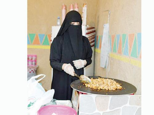 Nada Muhammad preparing food at her home.