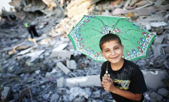 A Palestinian child stands in the rubble of destroyed houses in Gaza City's Shejaiya neighborhood.