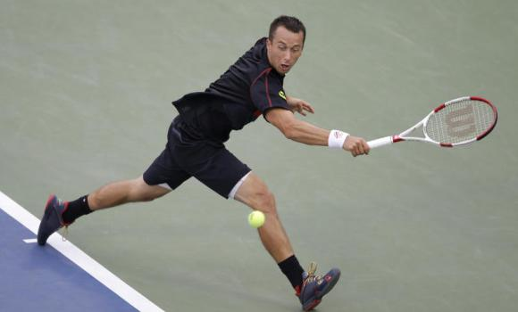 Philipp Kohlschreiber, of Germany, returns a shot against John Isner, of the United States, during the third round of the 2014 U.S. Open tennis tournament, Saturday, Aug. 30, 2014, in New York.