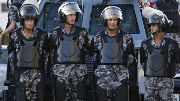 Riot police stand guard near the Israeli embassy in Amman July 31, 2014.