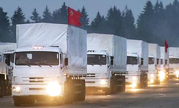 In this image taken from video a convoy of white trucks with humanitarian aid leaves Alabino, outside Moscow, on Tuesday. The convoy of 280 Russian trucks headed for eastern Ukraine early Tuesday, one day after agreement was reached on an international humanitarian relief mission. But the international Red Cross, which is due to coordinate the operation, said it had no information on what the trucks were carrying or where they were going.