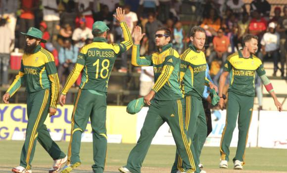 South African cricket players celebrate after beating Zimbabwe by 61 runs during the cricket One Day International match against Zimbabwe in Harare on Friday.