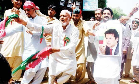 Supporters of Imran Khan dance in their protest march to Islamabad.
