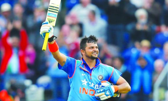 India's Suresh Raina celebrates getting 100 runs not out, during their One Day International cricket match against England at the SWALEC cricket ground in Cardiff, Wales, Wednesday.