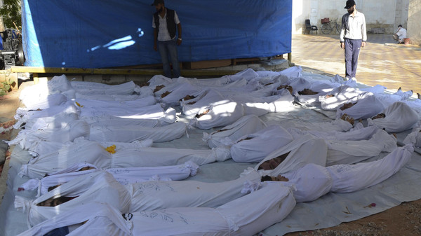 Syrian activists inspect the bodies of people they say were killed by nerve gas in the Ghouta region, in the Duma neighbourhood of Damascus, in this file picture taken August 21, 2013.