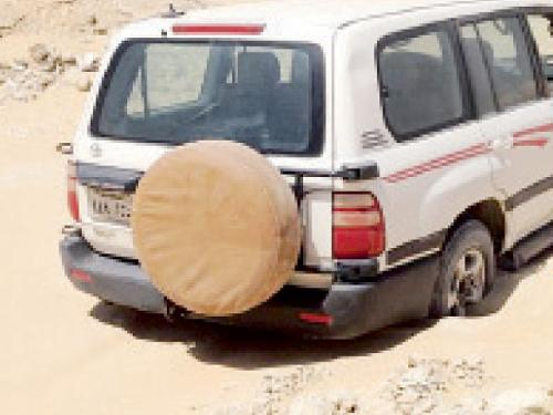 The missing man's car, which was found stuck in the sands in a desert area east of Melaijah, Eastern Province, on Monday.
