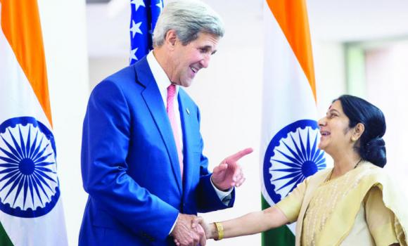 US Secretary of State John Kerry shakes hands with Indian Foreign Minister Sushma Swaraj in New Delhi on Thursday.