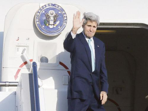 US Secretary of State John Kerry waves farewell after attending meetings in Sydney on Wednesday.