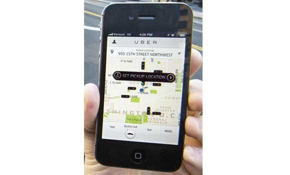 The Uber App is shown in this file photo in Washington, DC.