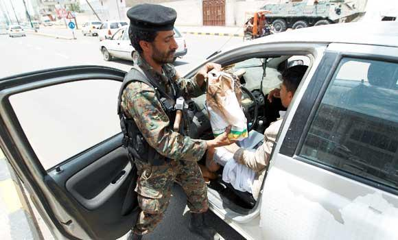 A Yemeni soldier checks a vehicle at a checkpoint amid fears of attacks by terrorist organizations, on Saturday, in the Yemeni capital Sanaa.