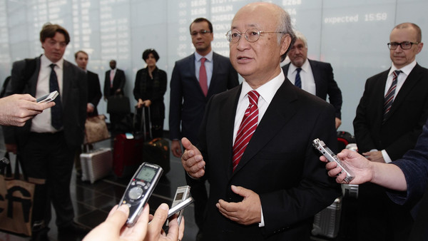 International Atomic Energy Agency (IAEA) Director General Yukiya Amano talks to the media as he arrives at Vienna's airport August 18, 2014.
