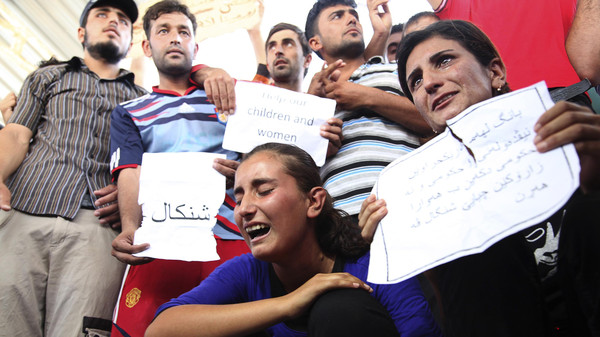 Displaced demonstrators from the minority Yazidi sect gather during a protest against ISIS militants in Arbil, north of Baghdad August 4, 2014.