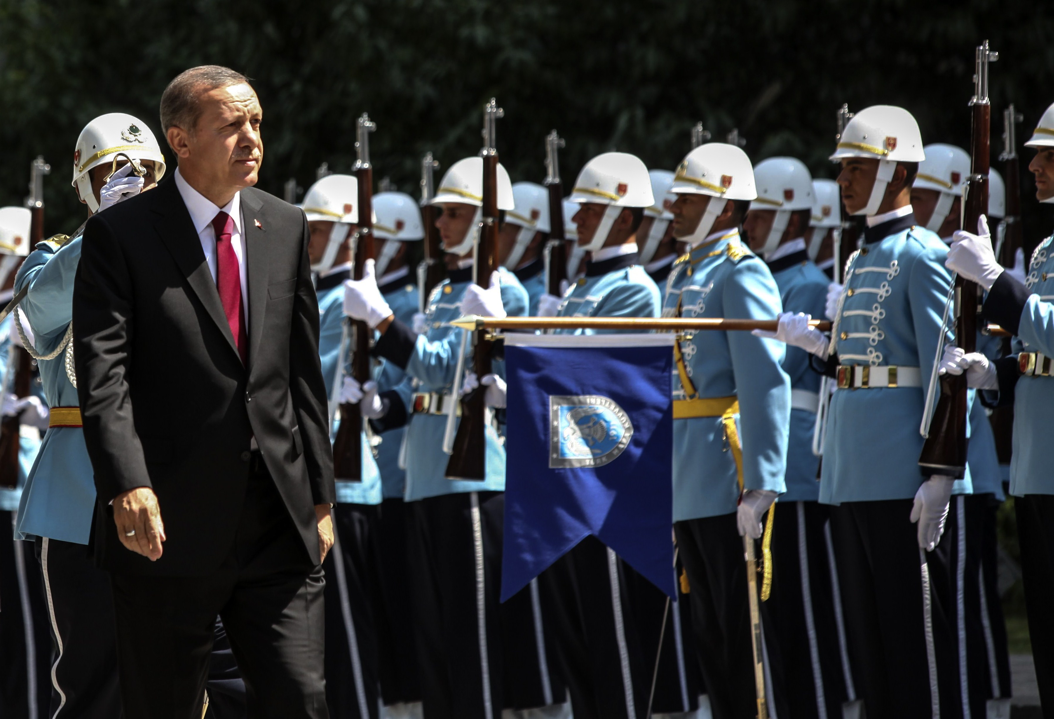 Turkey's new President Tayyip Erdogan (front) attends a swearing in ceremony in front the parliament building on August 28, 2014, in Ankara. Erdogan was sworn in as Turkey's 12th president at a ceremony in parliament on Thursday, cementing his position as the country's most powerful modern leader, in what his opponents fear will herald an increasingly authoritarian rule.