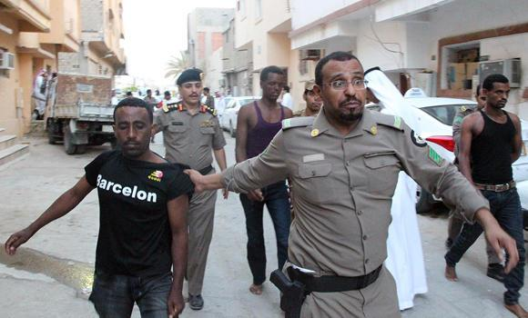 "Suspected ""illegals"" are rounded up by police during a raid in Riyadh's Manfouha district on Thursday."