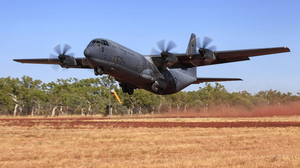 A C-130J Hercules aircraft takes off from Delamere Range Facility in the Northern Territory during Exercise Pitch Black 2014 in this picture released by the Australian Defence Force August 14, 2014.