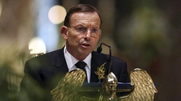 Australian Prime Minister Tony Abbott delivers remarks during a national memorial service for the victims of Malaysia Airlines flight MH17 at St Patrick's Cathedral in Melbourne.