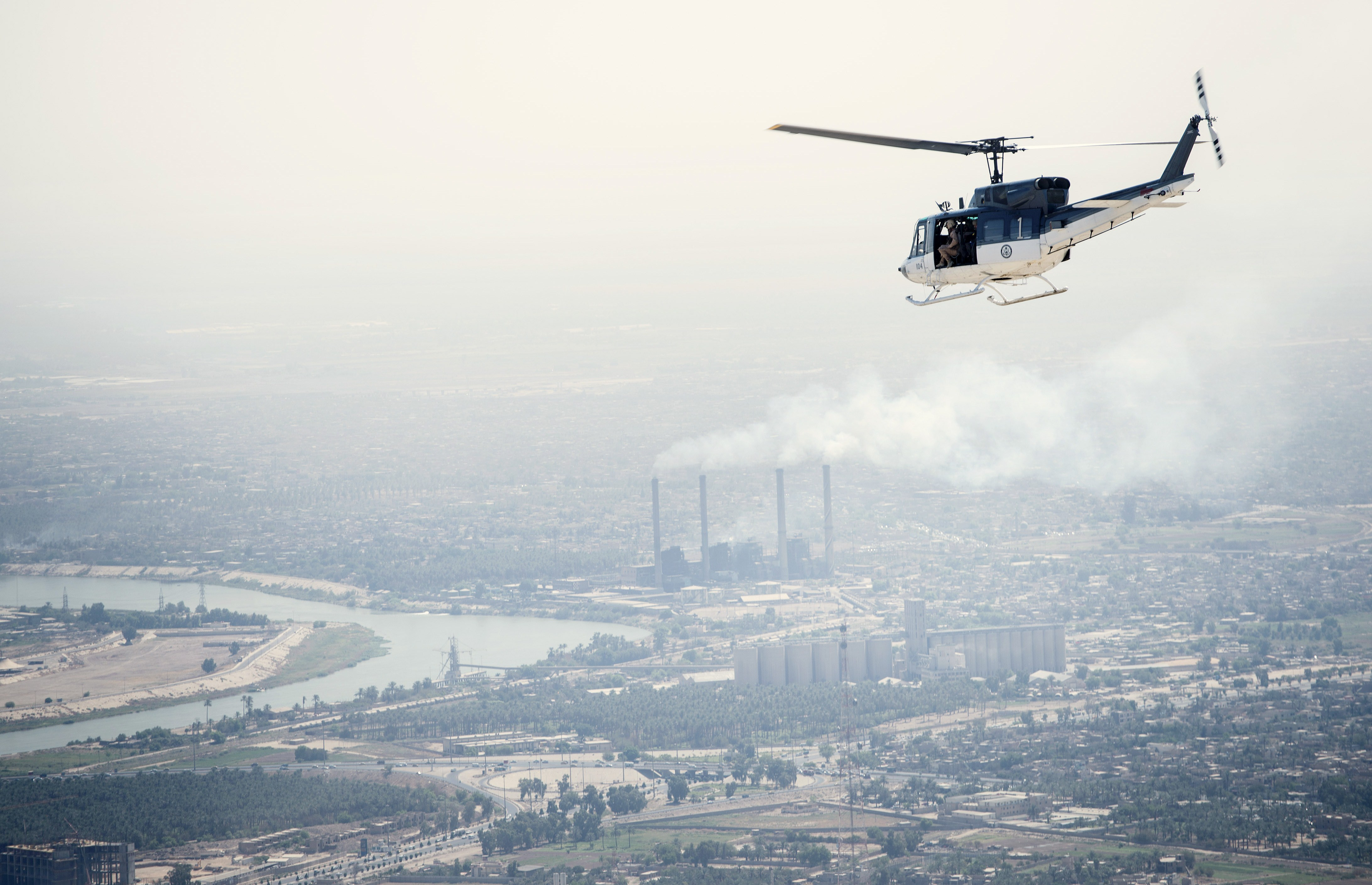 A US State Department helicopter flies over Baghdad on September 10, 2014. US Secretary of State John Kerry flew to the Iraqi capital to hold talks with Iraq's new leaders on their role in a long-awaited strategy against Islamic State jihadists to be unveiled by President Barack Obama.