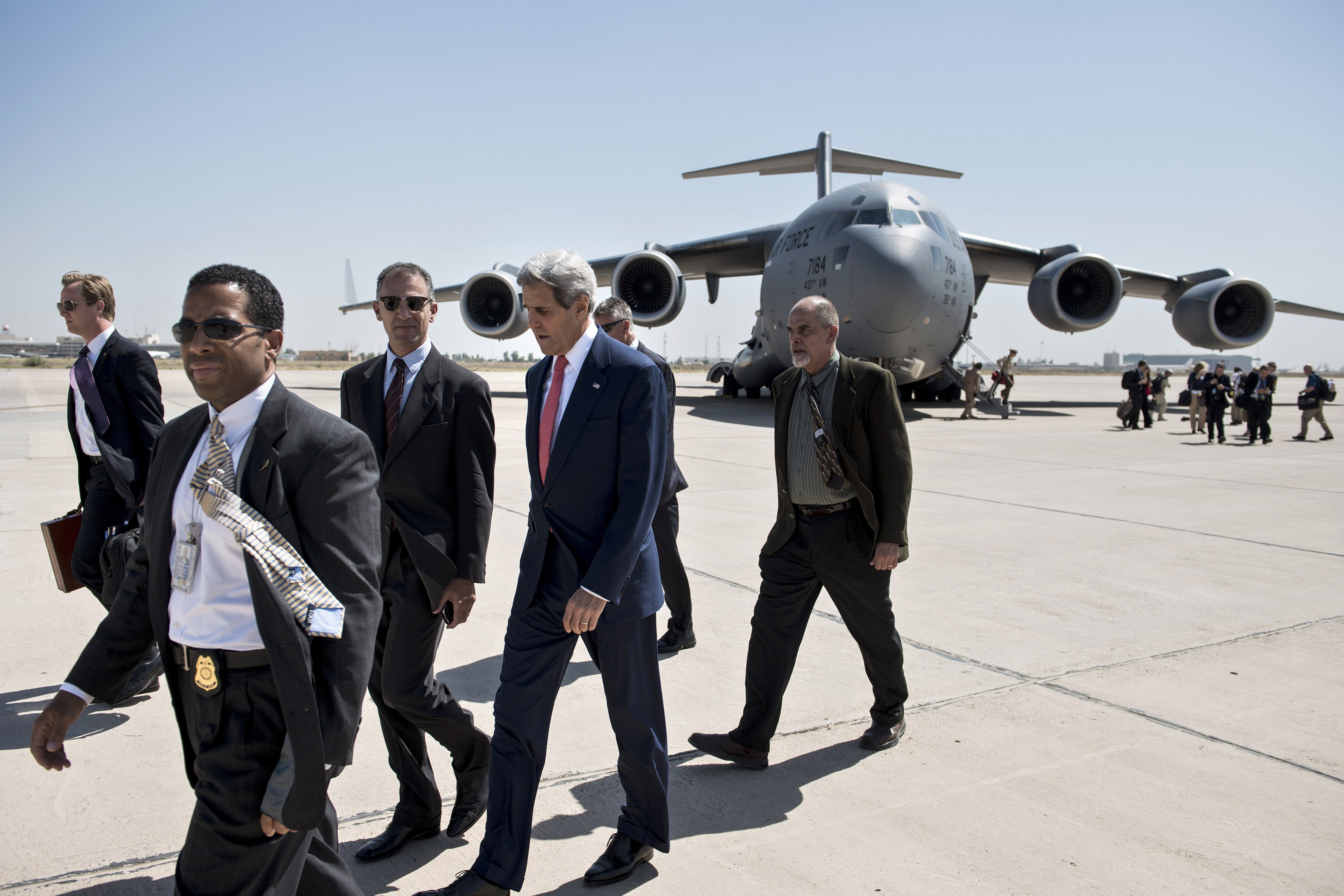 U.S. Secretary of State John Kerry (2R) arrives at Baghdad Airport on September 10, 2014.