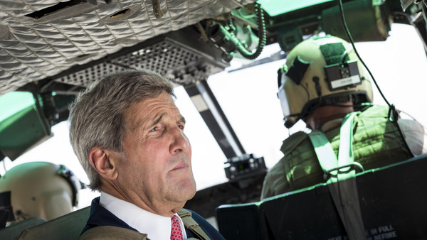 U.S. Secretary of State John Kerry rides in a helicopter September 10, 2014 in Baghdad.