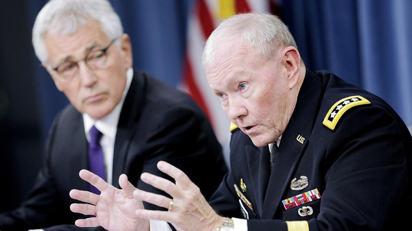 Joint Chiefs of Staff Chairman General Martin Dempsey, right, and Secretary of Defense Chuck Hagel speak to reporters at the Pentagon on Sept. 26, 2014 in Arlington, Virginia.