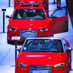 Carmakers force the smiles at Russia's car show