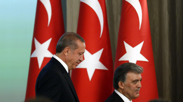 President Tayyip Erdogan (L) said senior Brotherhood figures would be welcome to come to Turkey if they wished.