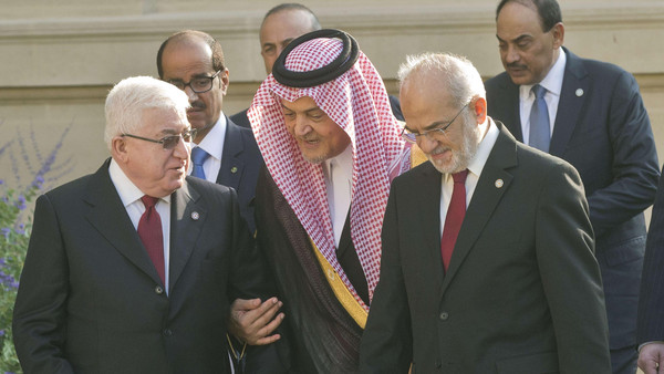 Iraqi President Fuad Masum, Saudi Foreign Minister Prince Saud al-Faisal and and Iraqi Foreign Minister Ibrahim al-Jaafari arrive at the International Conference on Peace and Security in Iraq on Sept. 15, 2014 at the French Foreign Ministry in Paris on Sept. 15, 2014.