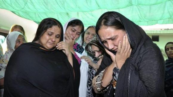 In a similar incident, relatives mourn over the body of Rashid Rehman, a lawyer who was killed by unidentified gunmen, at his residence in Multan May 8, 2014.