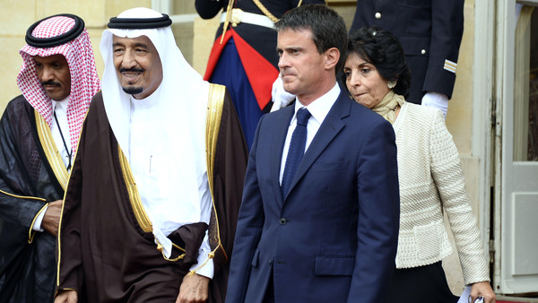 French Prime Minister Manuel Valls (L) welcomes Saudi Crown Prince Salman bin Abdulaziz prior to their meeting at the Hotel Matignon in Paris, on Sept. 2, 2014.