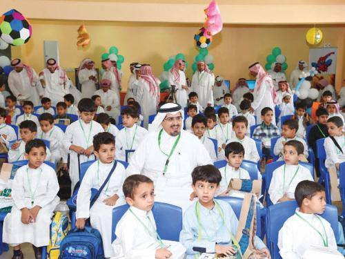 Students and teachers celebrate the start of the new academic year in a school in Abha. More than 258,000 boys and girls attended school in the Asir region on Sunday.
