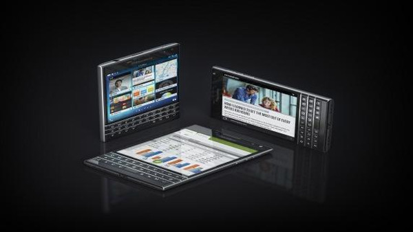 The new BlackBerry 'Passport' is the size and shape of a closed passport, with a large square touchscreen as well as a Keyboard.